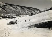 Aspen Ski School Class at Little Nell Beginners Slope.  Glory Hole Motel in Background.